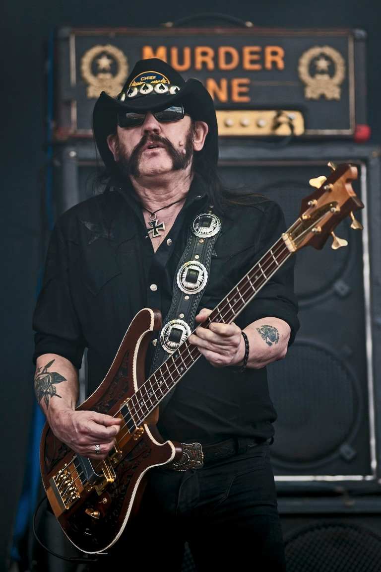 DONNINGTON, UNITED KINGDOM - JUNE 15: Lemmy Kilmister of Motorhead performs on stage on Day 2 of Download Festival 2013 at Donnington Park on June 15, 2013 in Donnington, England. (Photo by Neil Lupin/Redferns via Getty Images)
